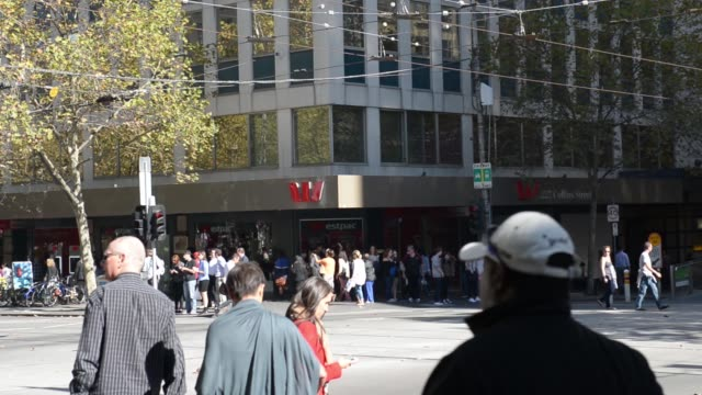 WS pedestrians walk past a Westpac Banking Corp office building MS Westpac logo is displayed at a bank branch window WS pedestrians cross a street...