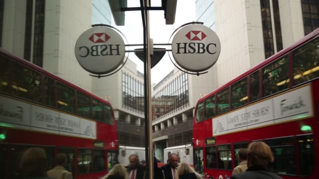 Pedestrians walk past an HSBC Holdings Plc bank branch in the City of London UK on Tuesday November 11 Pedestrians walk past HSBC automated teller...