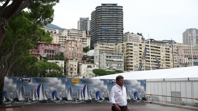 pedestrians walk past nautical themed hoardings ahead of the monaco yacht show in monaco, france, on wednesday, sept. 24 residential buildings and... - exklusiv stock-videos und b-roll-filmmaterial
