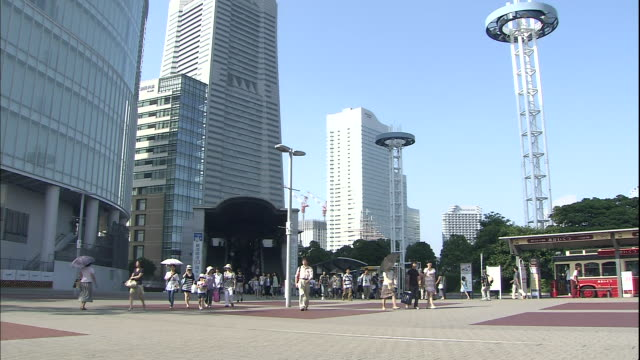 pedestrians walk past  sakuragicho station in kanagawa. - promenade stock videos & royalty-free footage