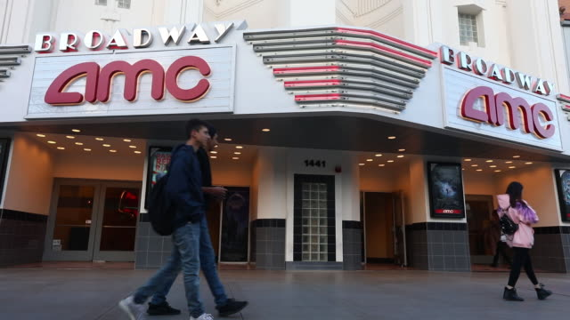 Pedestrians walk past the AMC Entertainment Inc Broadway 4 movie theater in Santa Monica California US on Tuesday February 27 2018
