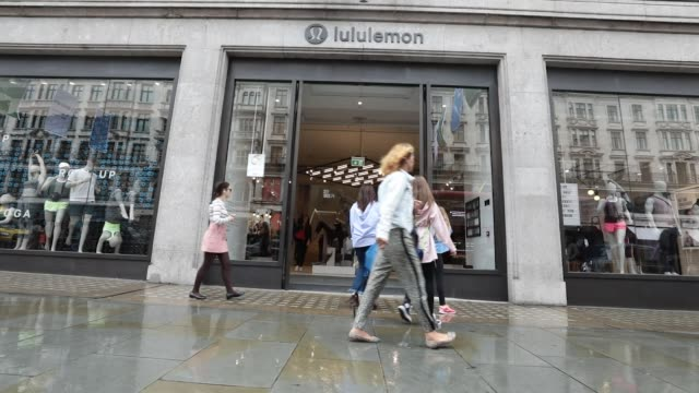 pedestrians walk past the lululemon athletica inc sports apparel store on regent street in london uk on thursday july 27 2017 - sportkläder bildbanksvideor och videomaterial från bakom kulisserna