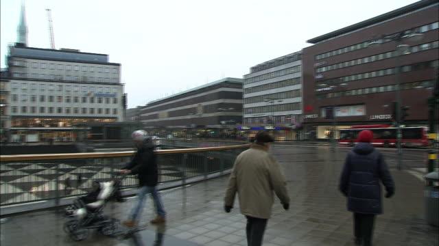 pedestrians walk past the slab in stockholm's sergels torg plaza. - three wheeled pushchair stock videos & royalty-free footage
