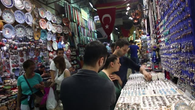 Pedestrians walk past tourist souvenir stores in the Grand Bazaar covered market in Istanbul Goods are seen for sale at a store in the Grand Bazaar...