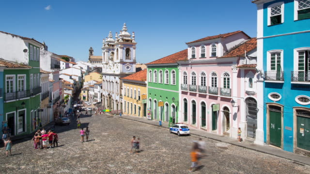 TL, WS Pedestrians walk through historic Largo do Pelourinho / Salvador, Brazil