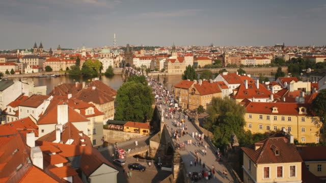 Pedestrians walk through Prague's Old Town and across the Charles Bridge.
