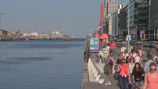 pedestrians walk through the silicon docks area in dublin ireland on august 23 2018 - music or celebrities or fashion or film industry or film premiere or youth culture or novelty item or vacations stock-videos und b-roll-filmmaterial