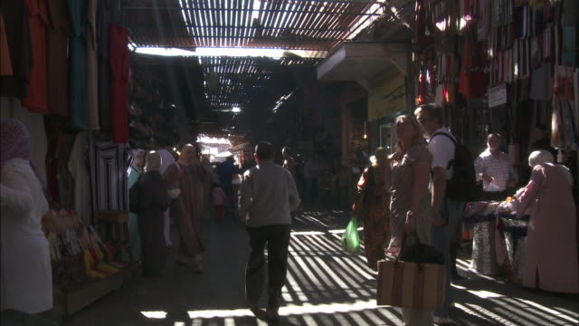 Pedestrians walk through the souk.