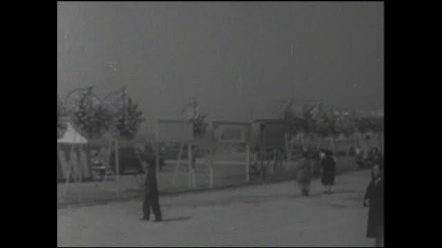 pedestrians walk toward the harumi pier to celebrate the opening of the port. - postwar stock videos & royalty-free footage