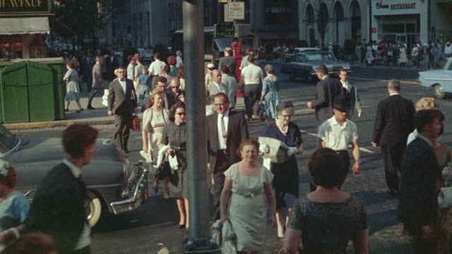 stockvideo's en b-roll-footage met 1963 ha ws pedestrians walking across busy manhattan street / new york city, new york - 1963