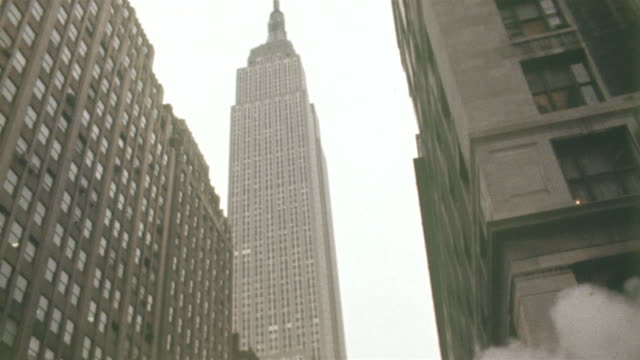 1978 montage ms la tu td pedestrians walking across street by steam stack, empire state building in background, new york city, new york state, usa - 1978 stock videos & royalty-free footage