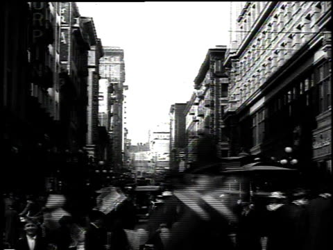 1916 ws pedestrians walking across street with traffic in background and buildings on both sides / san francisco, california, united states - 1916 stock videos & royalty-free footage