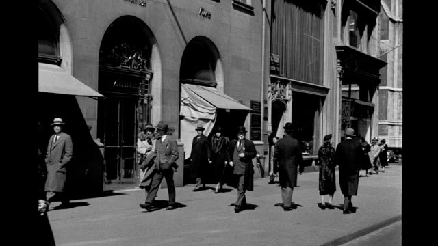 pedestrians walking along 5th avenue between 52nd and 53rd streets. pedestrians walking along 5th avenue on january 01, 1940 in new york city, new... - new york city 1930s stock videos & royalty-free footage