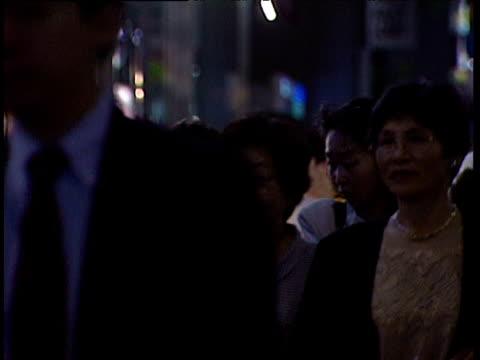 stockvideo's en b-roll-footage met pedestrians walking along busy street japan - 1991