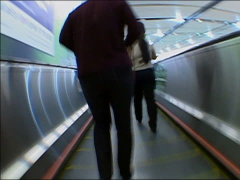 various ws ms mcu cu la ra dolly in slo mo pedestrians walking and standing on moving walkway. walking past on the other side on the walkway also in a blur. - other stock videos & royalty-free footage