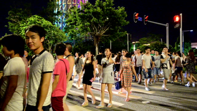 pedestrians walking at zebra crossing in urban city guangzhou street, real time. - zebra crossing stock videos and b-roll footage