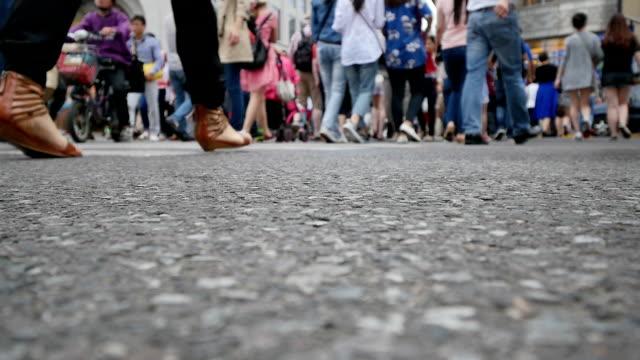 pedestrians walking at zebra crossing in urban city street,real time. - crosswalk sign stock videos & royalty-free footage
