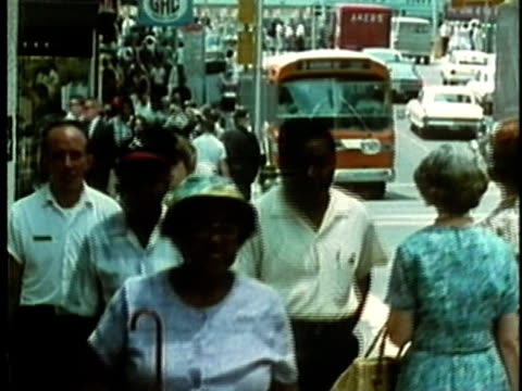 1969 montage pedestrians walking on busy city streets/ usa/ audio  - emigration and immigration stock videos & royalty-free footage