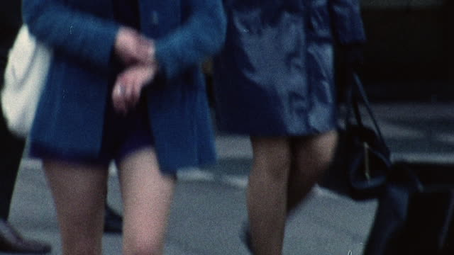 stockvideo's en b-roll-footage met 1974 montage pedestrians walking on busy roads / southampton, hampshire, england - hampshire engeland