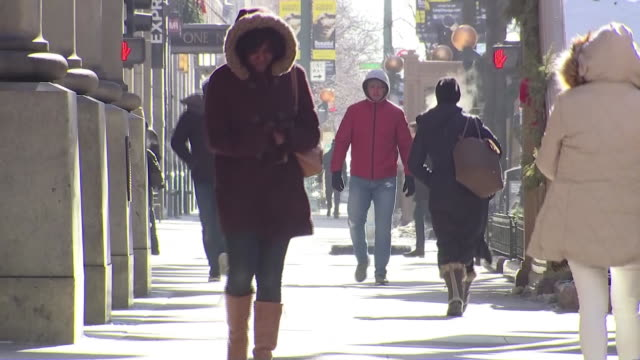 pedestrians walking on chicago sidewalk bundled up from a streak of freezing cold weather hitting much of the country - warm clothing stock videos & royalty-free footage