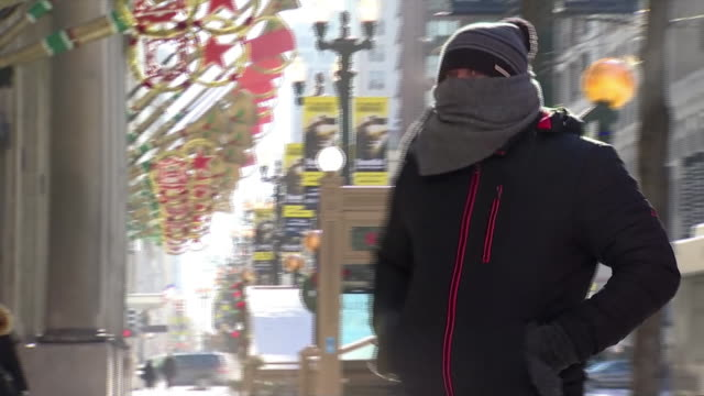 pedestrians walking on chicago sidewalk, bundled up from a streak of freezing cold weather hitting much of the country. - warm clothing stock videos & royalty-free footage