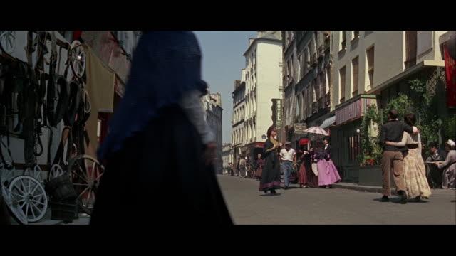 ws pedestrians walking on street - rievocazione video stock e b–roll