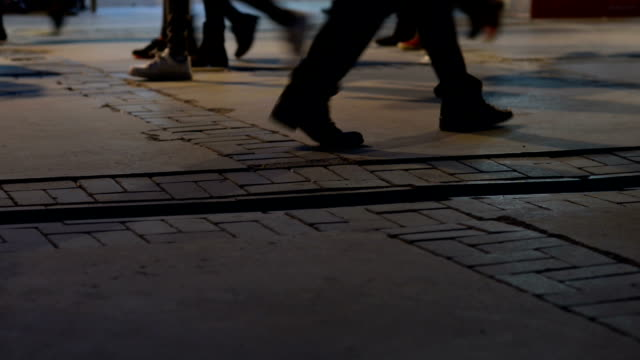 pedestrians walking on the street at night - pedestrian zone stock videos & royalty-free footage
