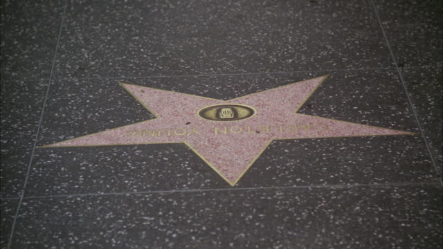 stockvideo's en b-roll-footage met cu tu pedestrians walking over stars - hollywood walk of fame