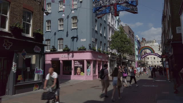 pedestrians walking past properties in soho owned by shaftesbury plc, who have noted an increase in demand for empty commercial spaces. iin london,... - fashionable stock videos & royalty-free footage