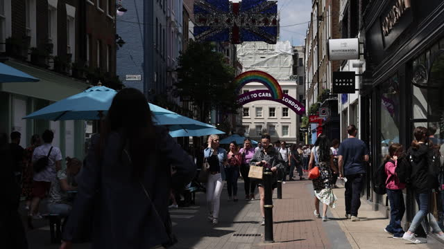 pedestrians walking past properties on carnaby street owned by shaftesbury plc, who have noted an increase in demand for empty commercial spaces. in... - fashionable stock videos & royalty-free footage