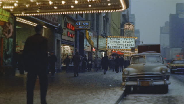 vídeos de stock e filmes b-roll de 1959 ws pedestrians walking past theatres near times square / manhattan, new york - 1950 1959