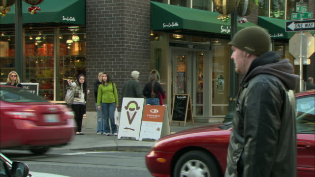 MS Pedestrians walking past upscale store on busy intersection of Pearl District / Portland, Oregon, USA