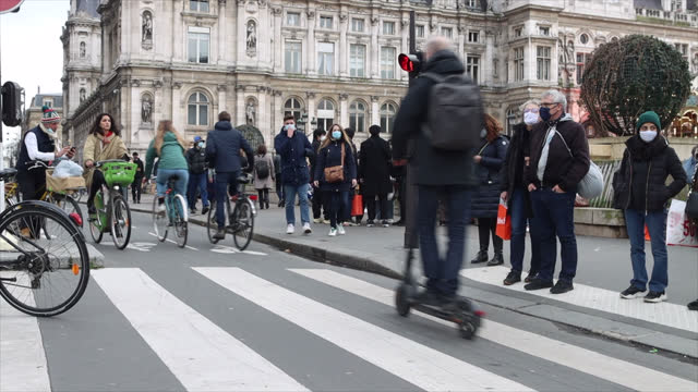 pedestrians wearing protective masks and cyclists, rue de rivoli near the paris town hall - france stock videos & royalty-free footage