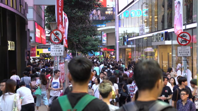 pedetrian in wanchai street hong kong - wanchai stock videos and b-roll footage