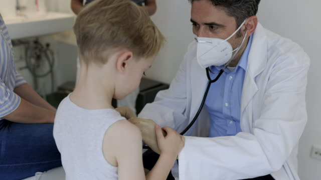 pediatrician checking little boy in his clinic - torso stock videos & royalty-free footage