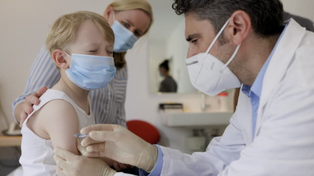 pediatrician giving vaccination to small boy - kids stock videos & royalty-free footage
