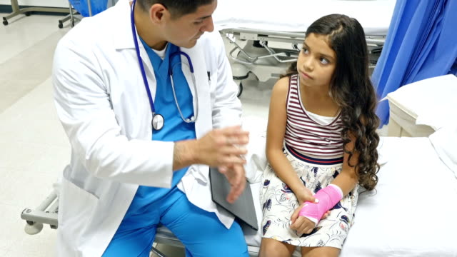 pediatrician instructs little girl about care of her cast - arm stock videos and b-roll footage