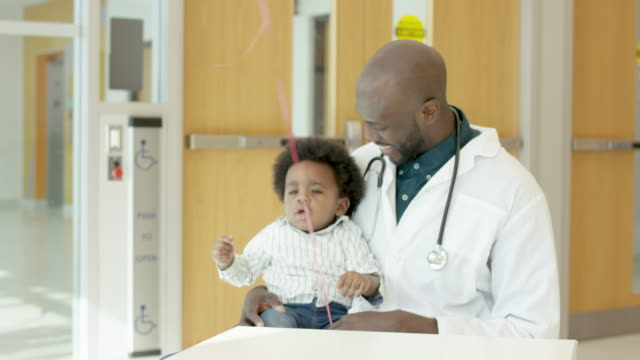 Pediatrician With Child Patient
