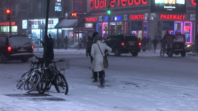 Pedicab struggling through streets of New York during a snow storm Available in HD