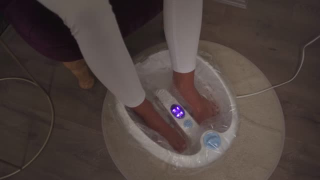 pedicure and foot massage in beauty salon - human foot stock videos & royalty-free footage