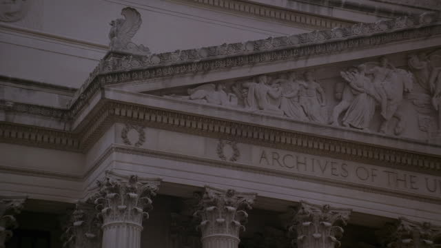PAN Pediment, bas relief sculpture, and inscription on the National Archives Building facade / Washington, D.C., United States