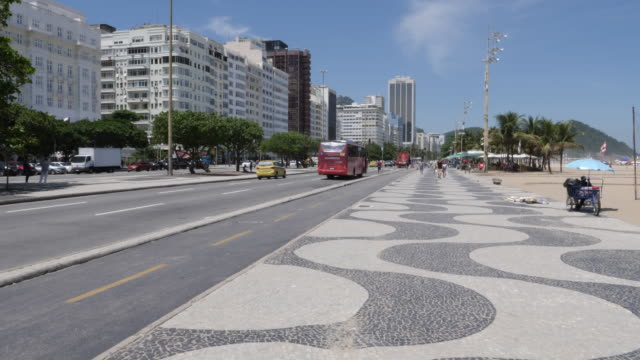 pedra portuguesa , designed with black and white stones of basalt and limestone at at copacabana beach on november 27, 2019 in rio de janeiro, brazil - basalt stock videos & royalty-free footage