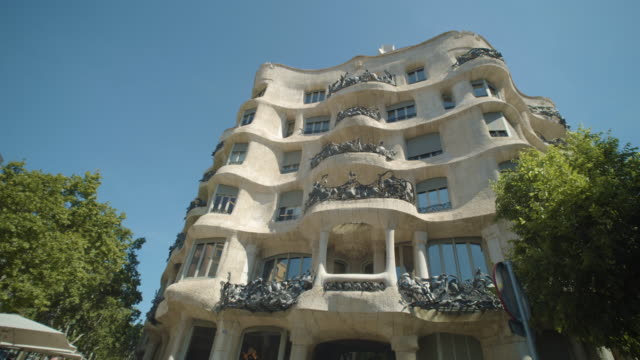 pedrera casa mila steadicam shot. famous building by antoni gaudí at barcelona, catalonia, spain - stone house stock videos & royalty-free footage