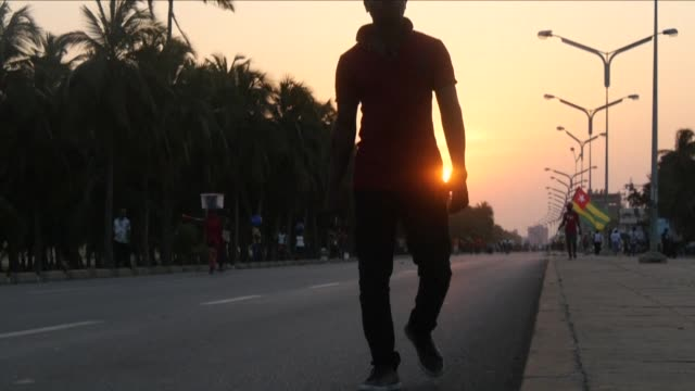 pedro is a young togolese man who has lived in benin for the last 10 years and every week he crosses the border to his home country in order to join... - benin stock videos and b-roll footage