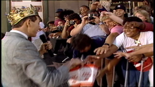 pee wee herman giving out popcorn to fans in los angeles california - paul reubens actor stock videos and b-roll footage