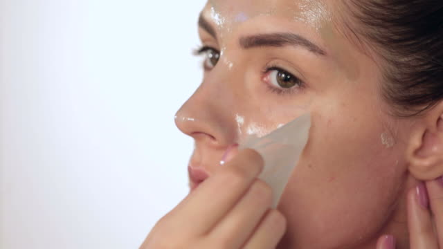 peel off mask - scrubbing stock videos & royalty-free footage