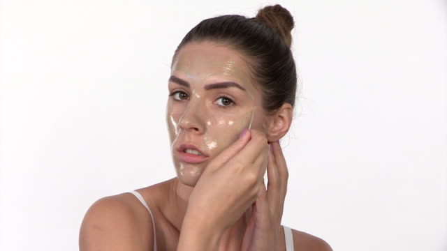 peel off mask - woman taking clothes off stock videos and b-roll footage