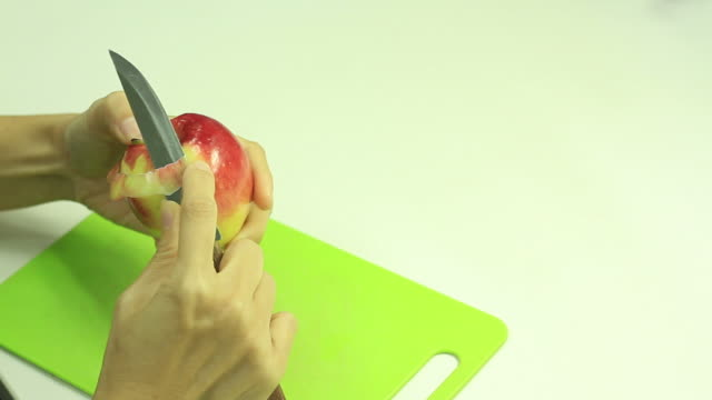 peel the apple - peel stock videos & royalty-free footage