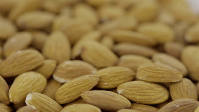 peeled almond -  4k video - brown stock videos & royalty-free footage