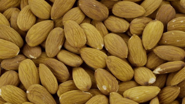 peeled almond - loopable 4k video - almond stock videos and b-roll footage